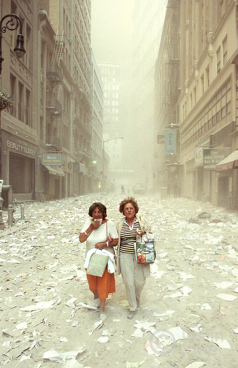 Two woman walk through an abandoned, ash-covered lower Manhattan following the collapse of the World Trade Center towers.<br />This photograph was awarded the 2002 Pulitzer Prize for Breaking News Photography.