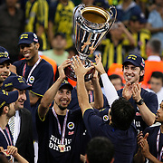 Fenerbahce's players Roko Leni UKIC (C) celebrate with the BEKO Basketball League Champions Cup trophy during their Turkish Basketball league Play Off Final Sixth Leg match Fenerbahce Ulker between Efes Pilsen at the Abdi Ipekci Arena in Istanbul Turkey on Wednesday 02 June 2010. Photo by Aykut AKICI/TURKPIX