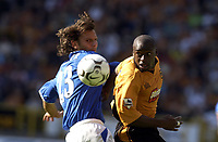 Copyright Sportsbeat Images. 01494 783165<br />Picture: Henry Browne<br />Date: 30/08/2003<br />Woverhampton Wanderers v Portsmouth FA Barclaycard Premiership<br />Shaun Newton of Wolves and Patrik Berger of Portsmouth both have a look at the ball