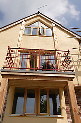 Front elevation of Eco House at The Wintles; Bishop's Castle showing extensive southfacing windows designed to maximise benefit of heat and light from the sun,