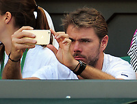 Tennis - 2017 Wimbledon Championships - Week One, Wednesday [Day Three]<br /> <br /> Women's Singles, Second Round match<br /> Johanna Konta (GBR) vs Donna Vekic (CRO) <br /> <br /> Stan Wawrinka takes a photo of his girlfriend, Donna Vekic on Centre court <br /> <br /> COLORSPORT/ANDREW COWIE