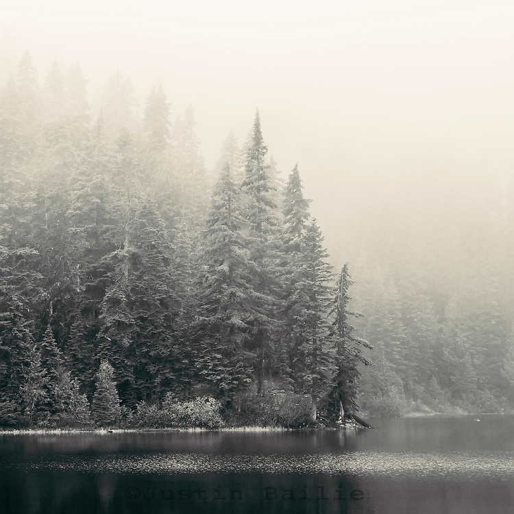 Early season snowstorm on alpine lake near Mt Rainier National Park.