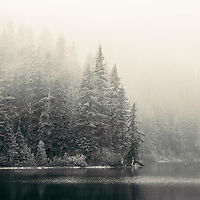 Early season snowstorm on alpine lake near Mt Rainier National Park.