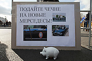 """Moscow, Russia, 22/10/2011..A poster reading """"Help give Chechnya a new Mercedes"""" at a Russian nationalist protest """"""""Stop Feeding The Caucasus"""" against the alleged over-subsidisation of the North Caucasus region, including Chechnya, by the central Russian government. The campaign has been organised by the Russian Public Movement and the Russian Civil Union, who have joined under the common banner of The Russian Platform."""