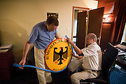 "Setting up the first German embassy in Djibouti. Germany's army presence is there to ""protect its foreign trade interests"" as well as part of its EU's Operation Atalanta.  Future German ambassador Jorg Kinnen (blue shirt) and retired ambassador Manfred Dohmeyer working on setting up the first German embassy in Djibouti, at their temporary office: a room at the Sheraton hotel...The geostrategical and geopolitical importance of the Republic of Djibouti, located on the Horn of Africa, by the Red Sea and the Gulf of Aden, and bordered by Eritrea, Ethiopia and Somalia."