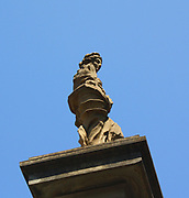 Sculptural street detail from Florence, Italy. A figurative sculpture.