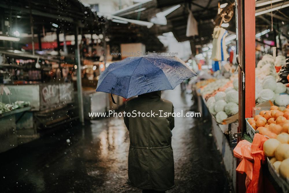 Rainy winter day in the outdoor Carmel Market, Tel Aviv, Israel