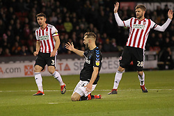 February 13, 2019 - Sheffield, South Yorkshire, United Kingdom - SHEFFIELD, UK 13TH FEBRUARY   Middlesbrough's Lewis Wing goes down inn the box after a challenge from Martin Cranie during the Sky Bet Championship match between Sheffield United and Middlesbrough at Bramall Lane, Sheffield on Wednesday 13th February 2019. (Credit: Mark Fletcher | MI News) (Credit Image: © Mi News/NurPhoto via ZUMA Press)