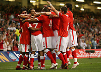 Photo: Rich Eaton.<br /> <br /> Wales v Cyprus. UEFA European Championships 2008 Qualifying. 11/10/2006. Wales players celebrate Robert Earnshaws  (hidden) goal in the first half