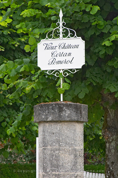 A stone gate post with a sign saying Vieux Chateau Certan  Pomerol  Bordeaux Gironde Aquitaine France