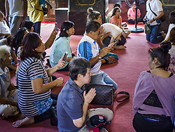 January 3, 2018 - Bangkok, Bangkok, Thailand - People pray for Bhumibol Adulyadej, the Late King of Thailand, at Wat Bowonniwet.  It is where the Late King Bhumibol and his son, the present King Vajiralongkorn were monks. Hundreds of people visit the temple every to pray for the late King, who died in October 2015 and was cremated in October 2016. Some of the revered King's ashes are interred at the temple. (Credit Image: © Sean Edison via ZUMA Wire)