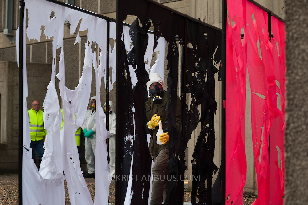 """The re-enactment of Acid Action Painting by Gustav Metzger on the South Bank, October 14, 2006. London.  In 1961 Gustav Metzger perfomed his seminal auto-destructive piece Acid Action Painting which was  re-enacted 45 years later, again at the South Bank, part of the Southbank show """"How to Improve the World"""".  The acid action painting was performed by Brian Hodginson under the instructions of Gustav Metzger himself."""