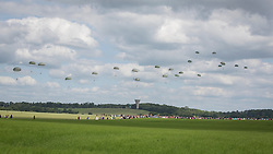 © Licensed to London News Pictures. 05/06/2014.   Members of the Parachute Regiment jump out of a Dekota aircraft over the village of Ranville in Normandy as part of the 70th Anniversary of the D Day landings.  Photo credit : Alison Baskerville/LNP