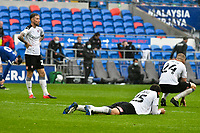 Football - 2020 / 2021 Sky Bet Championship - Cardiff City vs Rotherham United - Cardiff city Stadium<br /> <br /> Angus MacDonald Rotherham United Matt Crooks , left. as Rotherham United  & Michael Smith Rotherham United look <br /> fall to the floor after the final whistle .<br /> COLORSPORT/WINSTON BYNORTH