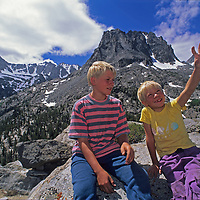 Ben & Nick Wiltsie (MR) sit atop granite dome in the John Muir Wilderness of California's Sierra Nevada.  Behind on the left are Mounts Gayley, Sill, North Palisade, Thunderbolt Peak and the Palisade Glacier.  In the back center is Mount Robinson.
