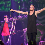 """WASHINGTON, DC - November 18, 2013 - Macklemore (right) performs at the Verizon Center in Washington, D.C. The Heist, his 2012 album with producer Ryan Lewis, contained the #1 singles """"Thrift Shop"""" and """"Can't Hold Us."""" (Photo by Kyle Gustafson / For The Washington Post)"""