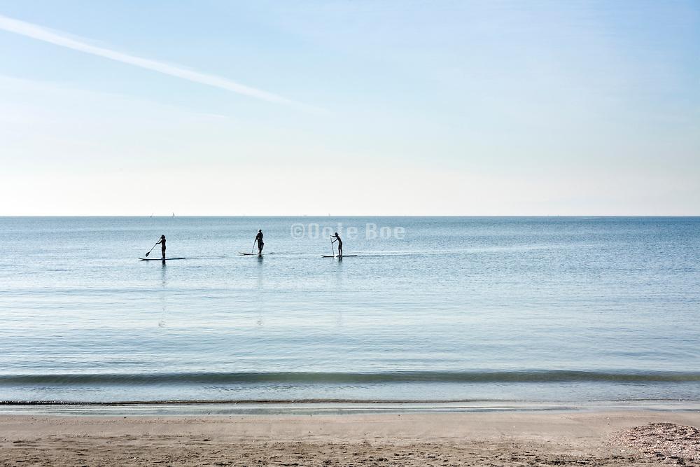 paddle boarding in Japan by Kamakura