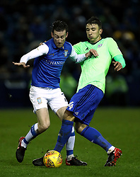 Sheffield Wednesday's David Jones (left) and Cardiff City's Sean Morrison battle for the ball