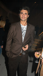 Singer DARIUS DANESH at an exhibition of work by Rolf Sachs - a unique world-renowned contemporary furniture designer, held in association with the Louisa Guinness Gallery and held at 250 Brompron Road, London on 6th October 2004.<br /><br />NON EXCLUSIVE - WORLD RIGHTS
