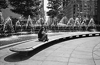 Texting at the Columbus Circle Fountain.