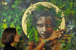 "© Licensed to London News Pictures. 06/10/2017. London, UK.  A woman views ""Ophelia"" by Dale Grimshaw at the Moniker Art Fair, the world's biggest urban art fair, taking place at the Old Truman Brewery in East London from 5 to 8 October 2017.  The fair brings together the world's most influential new-contemporary and urban art galleries to show international artworks to Londoners. Photo credit : Stephen Chung/LNP"