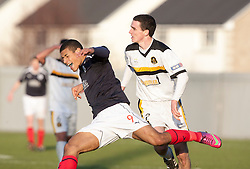 Falkirk's Lyle Taylor brought down by Dumbarton's PaulMcGinn..Dumbarton 0 v 2 Falkirk, 23/2/2013..©Michael Schofield.