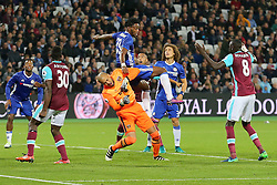 26 October 2016 - EFL Cup - 4th Round - West Ham v Chelsea - Michy Batshuayi of Chelsea lands on West Ham goalkeeper Darren Randolph after they battle for the ball - Photo: Marc Atkins / Offside.