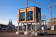 Germany, Cologne, the construction site of the building project MesseCity Koeln near the exhibition center in the district Deutz, model of the facade, in the background the cathedral<br /> <br /> Deutschland, Koeln, Baustelle des Grossprojektes MesseCity Koeln neben dem Messegelaende, Fassadenmodell, im Hintergrund der Dom.