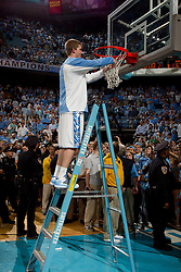 CHAPEL HILL, NC - MARCH 05: Stewart Cooper #15 of the North Carolina Tar Heels cuts down the net after defeating the Duke Blue Devils and winning the regular season ACC championship on March 05, 2011 at the Dean E. Smith Center in Chapel Hill, North Carolina. North Carolina won 67-81. (Photo by Peyton Williams/UNC/Getty Images) *** Local Caption *** Stewart Cooper