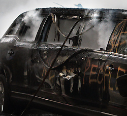 January 20, 2017 - Washington, DC, U.S - The remains of a limousine that was set on fire during clashes on President Donald Trump's inauguration day in Washington, D.C., on Jan. 20, 2017.  ''We the People'' was written on the limo. (Credit Image: © Carol Guzy via ZUMA Wire)