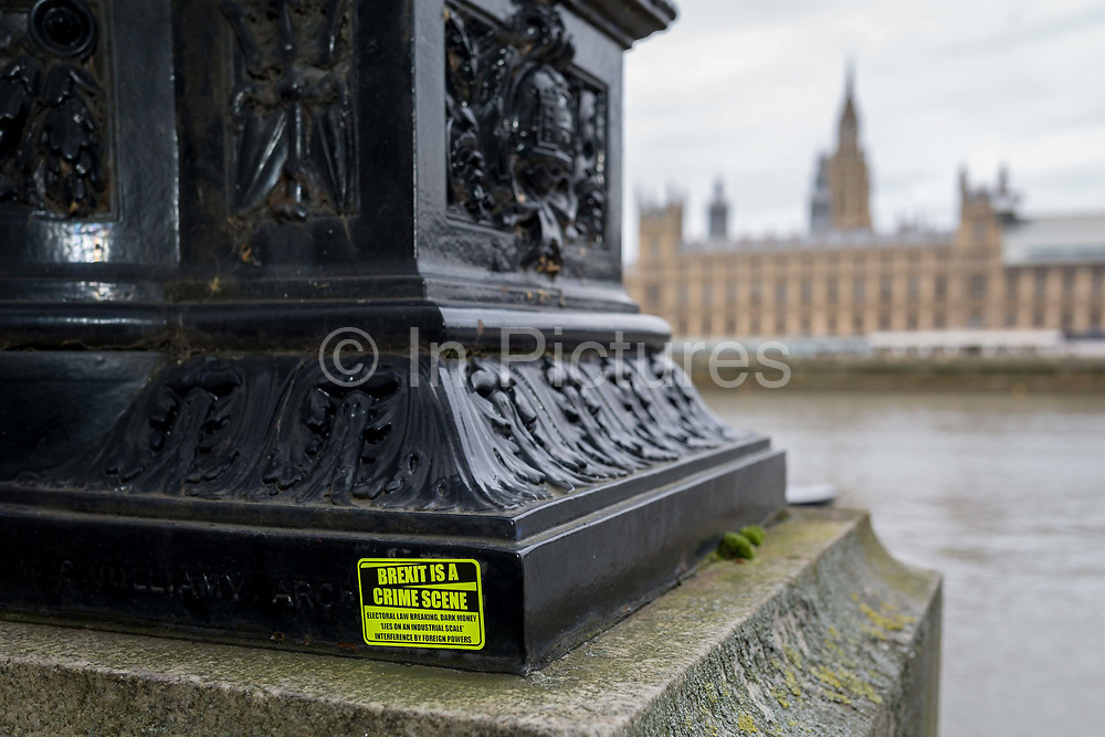 A sticker stating that this is a Brrexit crime scene, overlooking the Houses of Parliament across the river Thames in Westminster, on 27th March 2019, in London, England.