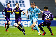 Viktor Gyokeres of Coventry City battles for possession with Derby County midfielder Graeme Shinnie  (4)  during the EFL Sky Bet Championship match between Coventry City and Derby County at the Coventry Building Society Arena, Coventry, England on 23 October 2021.