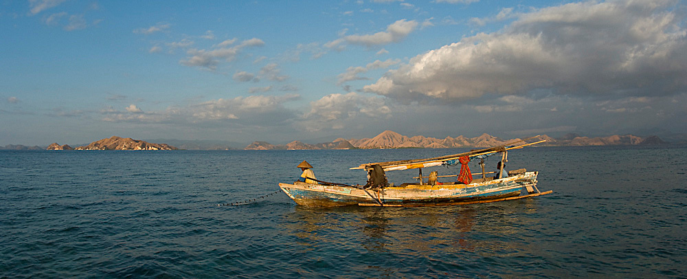 Fishermen fishing illegally in Komodo National Park, Indonesia. Although the park is designated as a protected area, enforcement of regulations is sporadic. Image available as a premium quality aluminum print ready to hang.