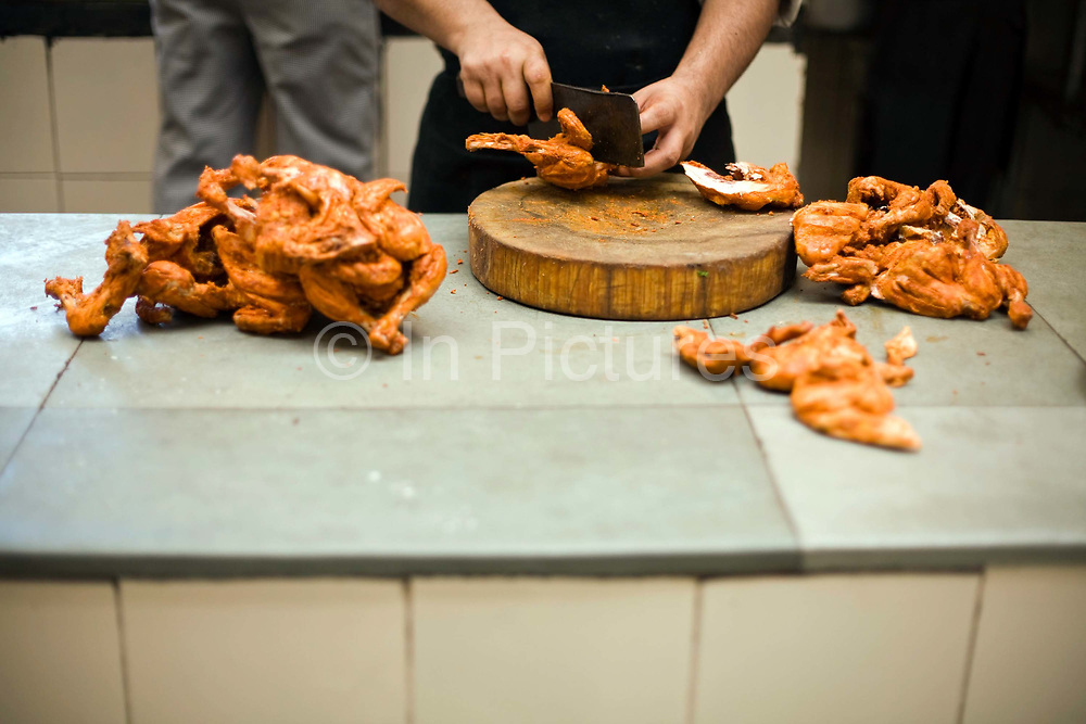 A chef prepares a dish of butter chicken at Moti Mahal Restaurant in Old Delhi, India<br /> The Moti Mahal restaurant, a Delhi landmark, opened in 1947 is widely credited with inventing the classic Delhi dish, butter chicken