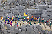 """The procession departs amongst the Inca ruins at Sacsayhuamán. Inti Raymi """"Festival of the Sun"""", Sacsayhuamán, Cusco, Peru."""
