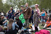 Climate change activists from the Extinction Rebellion group do breathing exercises at Parliament Square in protest that the government is not doing enough to avoid catastrophic climate change and to demand the government take radical action to save the planet, on 23rd April 2019 in London, England, United Kingdom. Extinction Rebellion is a climate change group started in 2018 and has gained a huge following of people committed to peaceful protests.