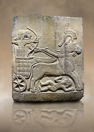 Photo ofHittite relief sculpted orthostat stone panel of Long Wall Basalt, Karkamıs, (Kargamıs), Carchemish (Karkemish), 900 - 700 B.C.  Anatolian Civilizations Museum, Ankara, Turkey<br /> <br /> Chariot. One of the two figures in the chariot holds the horse's headstall while the other throws arrows. There is a naked enemy with an arrow in his hip lying face down under the horse's feet. It is thought that this figure is depicted smaller than the other figures since it is an enemy soldier. The tower part of the orthostat is decorated with braiding motifs.<br /> <br /> On a brown art background. .<br />  <br /> If you prefer to buy from our ALAMY STOCK LIBRARY page at https://www.alamy.com/portfolio/paul-williams-funkystock/hittite-art-antiquities.html  - Type  Karkamıs in LOWER SEARCH WITHIN GALLERY box. Refine search by adding background colour, place, museum etc.<br /> <br /> Visit our HITTITE PHOTO COLLECTIONS for more photos to download or buy as wall art prints https://funkystock.photoshelter.com/gallery-collection/The-Hittites-Art-Artefacts-Antiquities-Historic-Sites-Pictures-Images-of/C0000NUBSMhSc3Oo