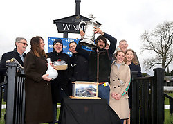 Trainer Christian Williams (centre right) and winning connections are presented with the winners trophy after seeing Potters Corner ridden by James Bowen win the Marstons 61 Deep Midlands Grand National race at Uttoxeter Racecourse.