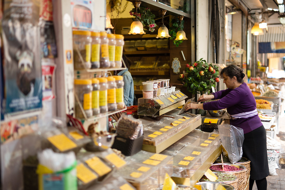 An Israeli vendor is seen at a spices and herbs market stall, in the Levinsky Market in southern Tel Aviv, Israel, on April 16, 2015. The majority of the Levinsky Market vendors are traditional Iranian Jews, many of whom fled the Islamic Republic after Ayatollah Khomeini rose to power in 1979