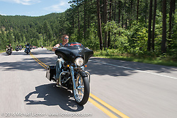 Moonshiner Josh Owens on the annual Cycle Source and Michael Lichter Rides (combined this year) during the Sturgis Black Hills Motorcycle Rally. SD, USA.  August 10, 2016.  Photography ©2016 Michael Lichter.