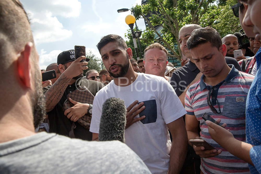 British professional boxer, Amir Iqbal Khan, showing his support for the victims of Grenfell Tower on the 17th June 2017 in North Kensington, London, United Kingdom. The Grenfell Tower fire occurred on 14th June 2017 at the 24-storey block of public housing flats in North Kensington, West London. It caused at least 80 deaths and over 70 injuries, yet the actual numbers have yet to be confirmed