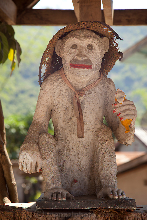 Monkey carving at the Buddhist temple in the Lao Whisky village or Ban Xang Hai village on the Mekong River near Luang Prabang. Known for potent rice wine, weaving and a small Buddhist temple in the village. A tourist stop on the way to Pak Ou (also called Tam Ting Caves)