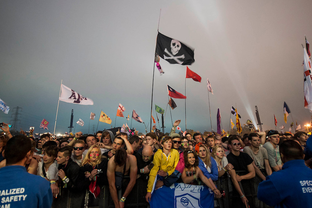 The audience waits for the Arctic Monkeys to play the Pyramid Stage. The 2013 Glastonbury Festival, Worthy Farm, Glastonbury. 28 June 2013. © Guy Bell, guy@gbphotos.com, all rights reserved