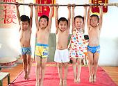 Children Put through Extreme Gymnastics Training Session