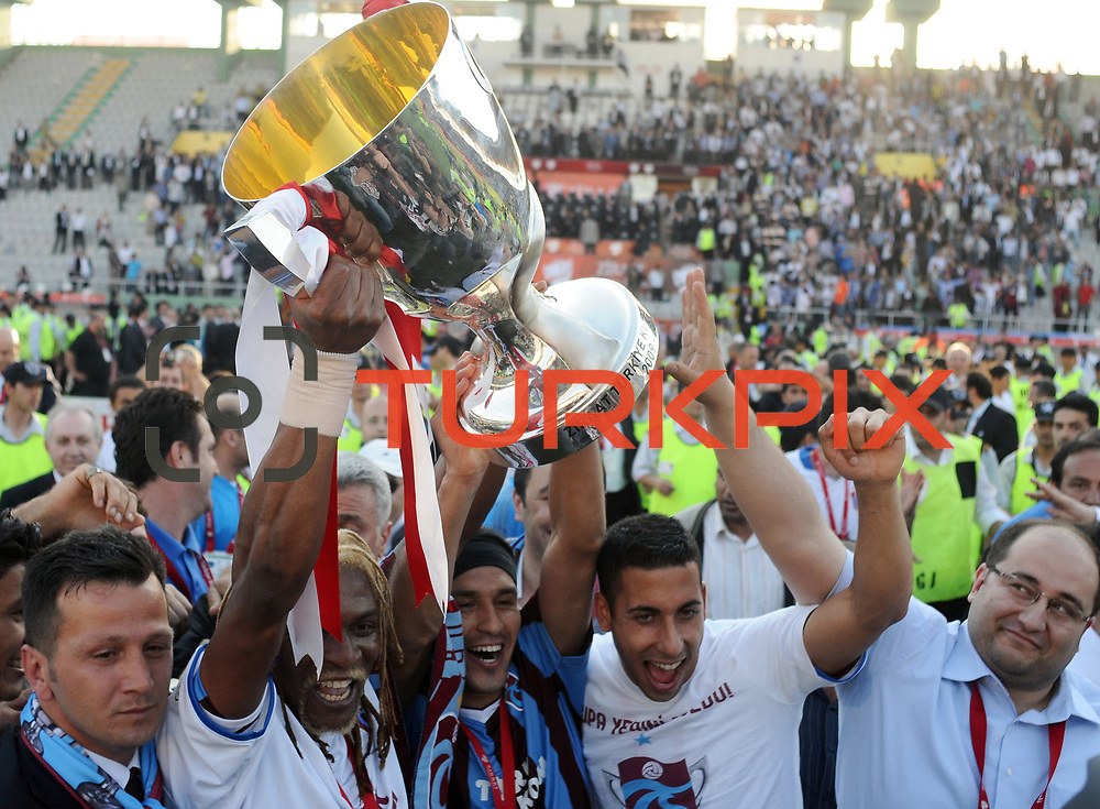 Jubilant Trabzonspor players Rigobert Song BAHANAG (2ndL), Gustavo COLMAN (C)  lifting up the cup at the ceremony during their after the Turkey Cup final match Trabzonspor between Fenerbahce at the GAP Arena Stadium at Urfa Turkey on wednesday, 05 May 2010. Photo by TURKPIX