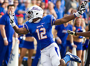 Dec 1, 2012; Tulsa, Ok, USA; Tulsa Hurricanes wide receiver Jordan James (12) attempts to make a catch during a game against the University of Central Florida Knights at Skelly Field at H.A. Chapman Stadium. Tulsa defeated UCF 33-27 in overtime to win the CUSA Championship. Mandatory Credit: Beth Hall-USA TODAY Sports