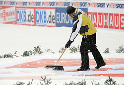 Cleaning the sponsor`s logo due to snow showers at Ski Jumping ladies Normal Hill Individual of FIS Nordic World Ski Championships Liberec 2008, on February 20, 2009, in Jested, Liberec, Czech Republic. (Photo by Vid Ponikvar / Sportida)