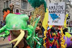 London, UK. 4th September, 2021. Extinction Rebellion activists highlight climate change in the Amazon rainforest during a colourful March for Nature on the final day of their two-week Impossible Rebellion. Extinction Rebellion are calling on the UK government to cease all new fossil fuel investment with immediate effect.