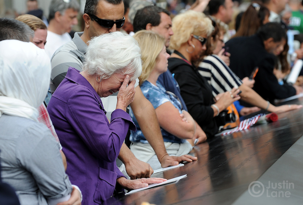 A woman cries while looking at the names inscribed at the North Pool of the 9/11 Memorial during tenth anniversary ceremonies at the site of the World Trade Center September 11, 2011, in New York. POOL/Justin Lane/EPA