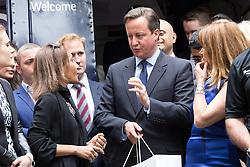 © Licensed to London News Pictures. 23/06/2015. London, UK. DAVID CAMERON receives gifts at the launch of the Start-Up Britain campaign routemaster bus in Downing Street, London with Prime Minister, David Cameron. Over five weeks the routemaster bus will visit 30 towns and cities - including Aberdeen, Inverness, Swansea York and Leeds - and aim to engage with 15,000 individuals through workshops and networking events, making them aware of the assistance Start-Up Britain can offer. Photo credit : Vickie Flores/LNP